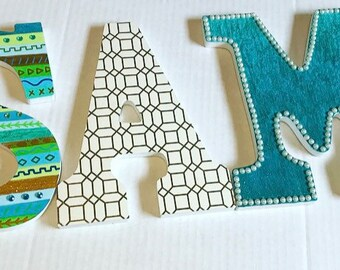 Blue and green aztec print wooden letters