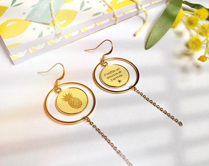 1 pair of branded leather earrings