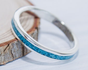 Skinny sterling silver ring with a continuous loop of crushed Turquoise