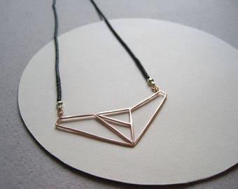 24ct rose gold vermeil geometric pendant on grey Japanese glass beads