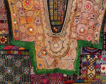 Embroidered vintage Indian diaries to create quilts, or customization, garment decoration