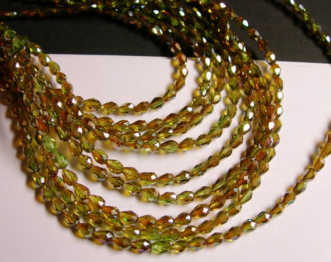 Faceted teardrop crystal beads - 100 pcs - 3mm x 5mm - sparkle golden amber mystic - CLGD14