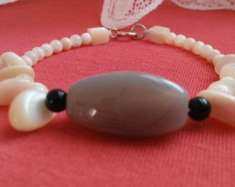 This Mother of pearl, Onyx and smoky quartz bracelet is comfortable and goes with anything. Nice.