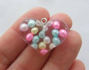 2 Heart resin pendants H11