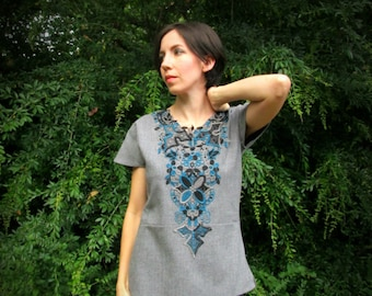 S. Lace applique tunic, gray, teal, and black, with peplum, vents, zipper. Cotton fabric.