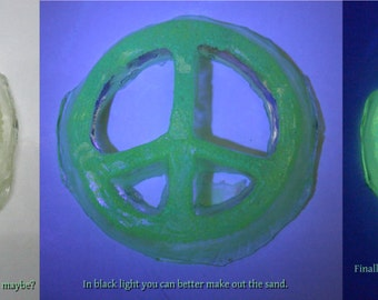 Glow-in-the-dark Peace Sign made of resin and glow-in-the-dark sand