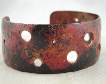 Red copper bangle bracelet with holes.  Steampunk design. ON SALE NOW