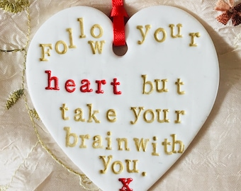 Clay 'Follow your heart but take your brain with you' hanging