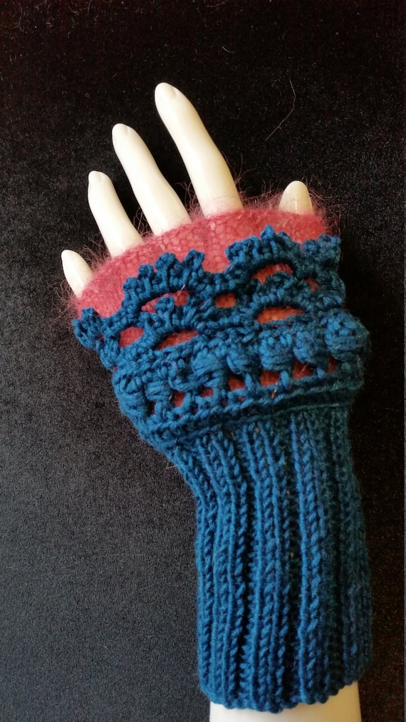 L404.  Wristlets .  Hand knitted wristlets with crochet finish