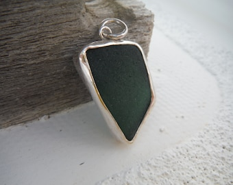 Dark green reversible sea glass pendant bezel set in sterling silver with simple masculine design