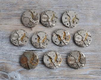 RAKETA 0.9 inch Set of 10 vintage wrist watch movements.