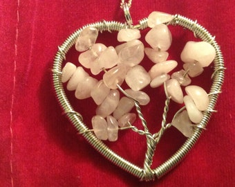 Pink Quartz heart Necless Jewelry to help you heal your heart, attract your soulmate and help you sleep.
