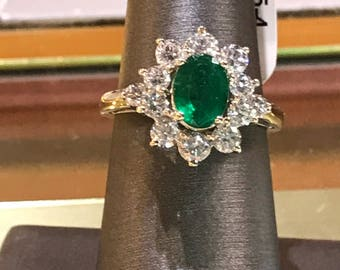 14 k white gold oval shaped emerald and diamond ring