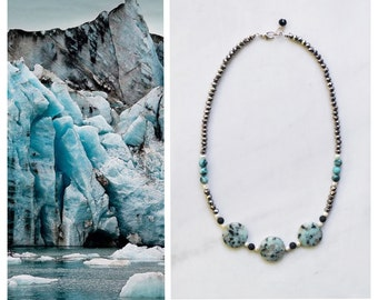 CSN010 - Statement necklace with mint green-turquoise jasper and jade, white pearls, black lava stones and silver crystals