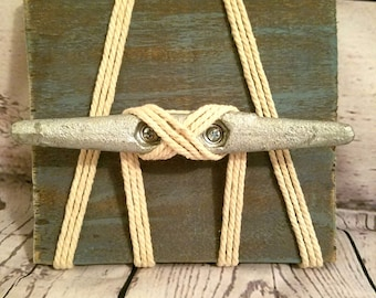 Boat cleat on wood wrapped in rope