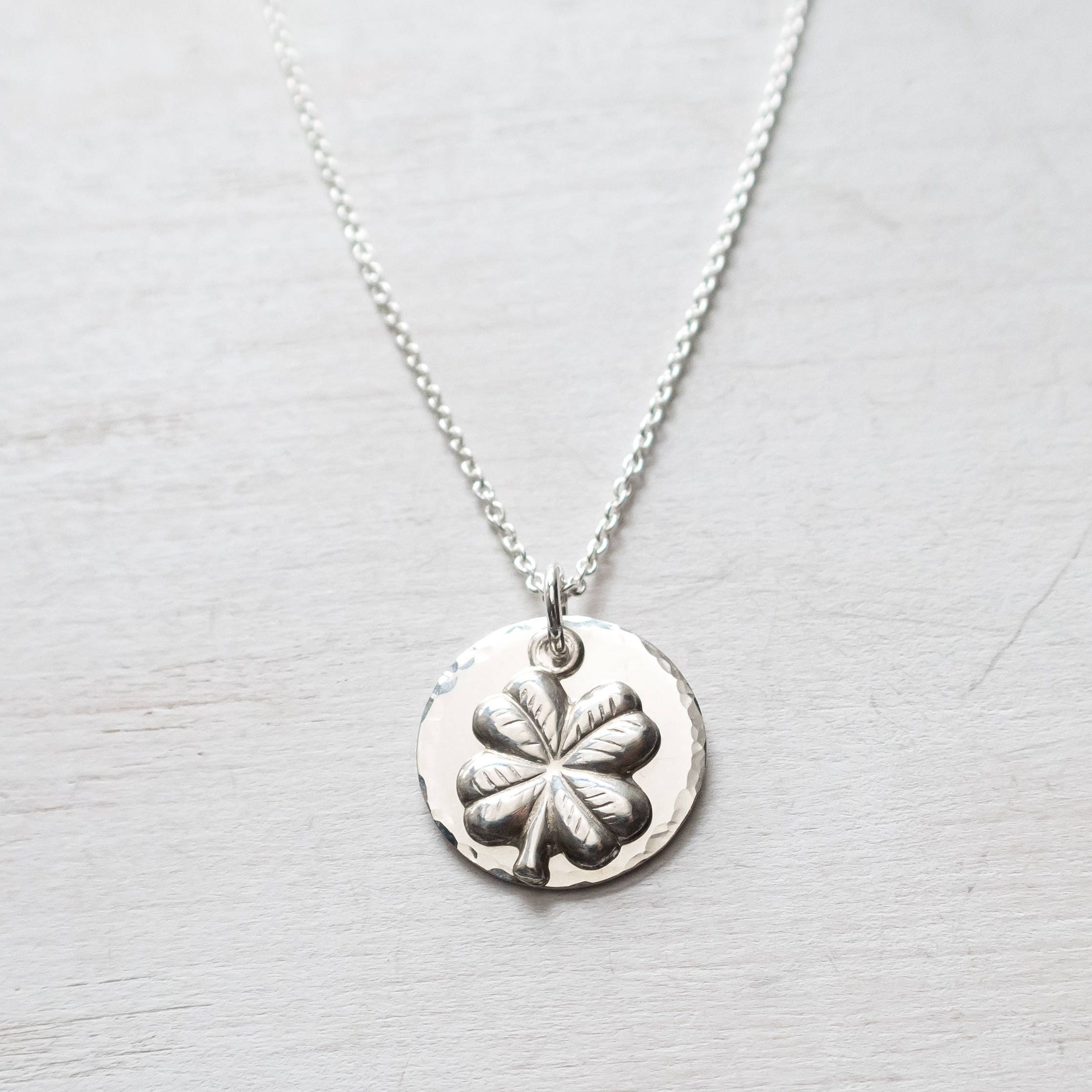 ani and clover front necklace super four alex charm leaf