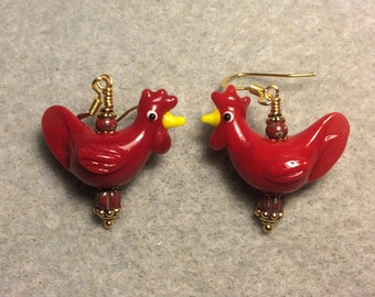 Bright red lampwork chicken bead earrings adorned with red Czech glass beads.