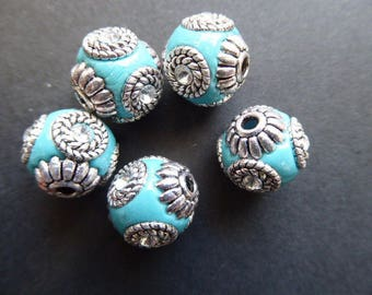 1 turquoise 14 mm hole 2 mm Indonesian bead