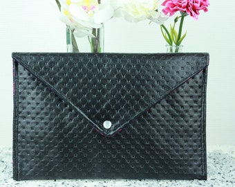 Black printed leather clutch