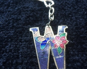 Sea Gem stamped Cloisonne letter W with butterfly and flower detail keyring