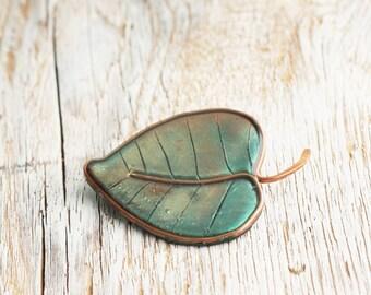 Dark green leaf brooch
