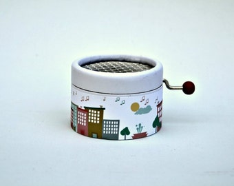 Little personalized music box. City of music. Hand cranked. Personalized with the melody you choose from the list.