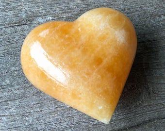 Orange calcite heart- 365 g