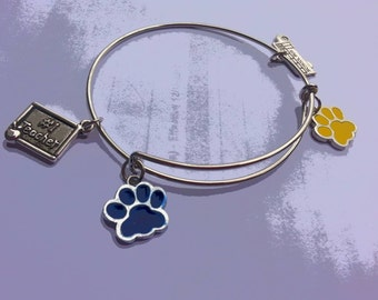 Blue and Yellow Paw Print school themed bangle bracelet