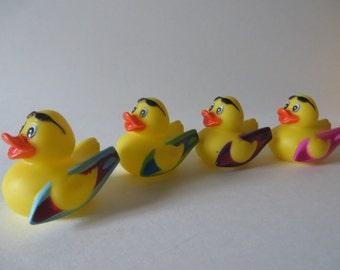 Surfing rubber ducks.- Hang Ten!