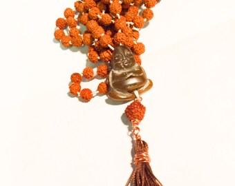 Rudraksha 108 bead Mala Necklace on knotted white silk cord with a carved stone Buddha guru bead and brown silk tassel