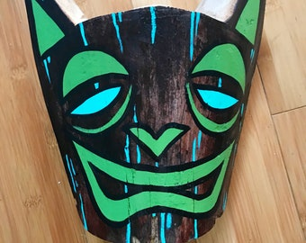 Signed TIKI CAT tiki mask made from a palm frond