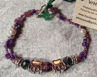 Glass beaded bracelet, size MEDIUM. Purple mix, silver findings, dog or cat paws, Boho, hippie, fair trade, gift, free shipping. Made in USA