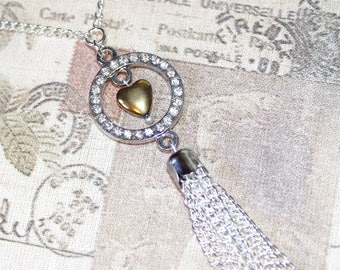 Flapper/1920's long silver plate necklace with gold heart & rhinestone tassel pendant