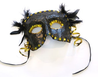 Black and gold paper mâché mask with feather and sequin detail