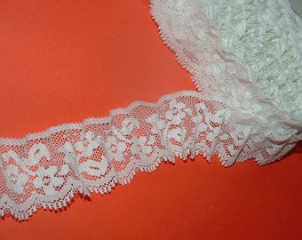5 yards long and 1 1/2'' wide White Lace with Floral design , Scalloped edge and Straight Edge