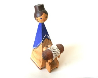Beautiful blue hand painted wooden  figurine figure - making lace