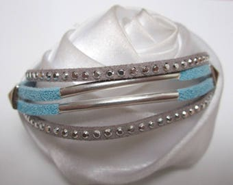 sequined turquoise suede strap curved tubes