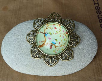 Vintage brass birds on a tree with green floral brooch