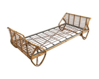 A rattan bed with mattress