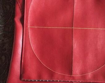 Red messenger bag with circle pattern design