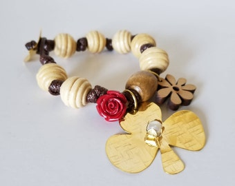 Woven bracelet with wooden beads