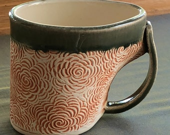 Green and orange textured mug