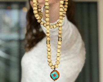 Gold Inlaid Bone Mala with Amber and Turquoise Pendant