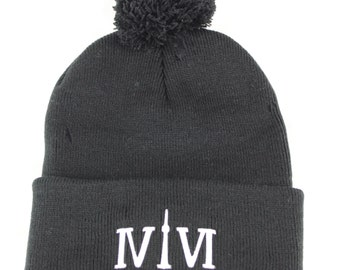 """Black Pom Pom 416 toques. The Roman Numerals Stand For """"416"""", with the """"1"""" resembling the CN Tower. We Are Toronto Beautiful."""