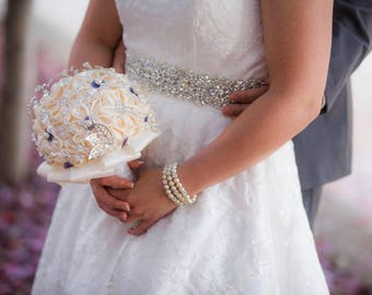 Ivory and blue ribbon and brooch bouquet