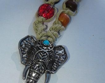 Elephant pendant on beige hemp with glass beads