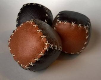 Three square style handmade leather juggling balls
