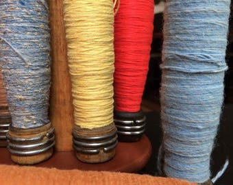 antique spindles and bobbins