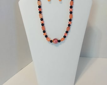 Beautiful 16 inch Black and Orange Glass Beaded Necklace set. Nickel free.