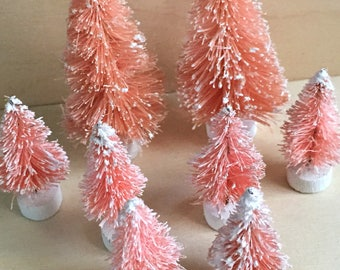 Pink Bottle Brush Trees, Set of 8 Mini Christmas Trees with Frost. By Darice. From 1 to 3 inches tall.